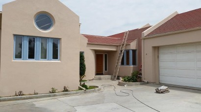 Pacific Sand Colored Stucco House
